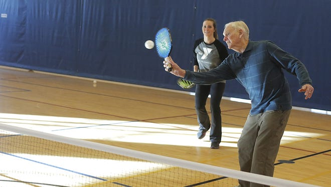Dick Naslund, right, National Senior Games Association Male Athlete of the Year, plays pickleball with Siri Smits on Friday, Feb. 3, 2017, at the Oshkosh YMCA. He turns 92 on Feb. 7, 2017.