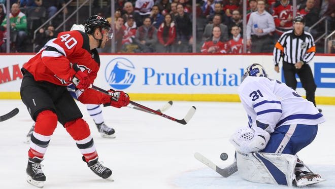 Apr 5, 2018; Newark, NJ, USA; Toronto Maple Leafs goaltender Frederik Andersen (31) makes a save on New Jersey Devils right wing Michael Grabner (40) during the second period at Prudential Center.