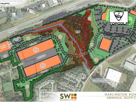 Developer Neil Wilson of RealtyLink started circulating this preliminary 90-acre site plan in mid April 2018 for his TopGolf project at Pelham Road and Interstate 85. The three orange buildings to the left are part of a proposed distribution center at the site, but a black line through the two longer buildings indicates where Wilson's property line ends. Members of the Durham family still owned the land to the left of that line as of April 17, 2018, and it is zoned residential, which would not allow the two warehouse buildings depicted here to be built.