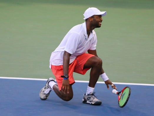 Donald Young  of the United States celebrates his five
