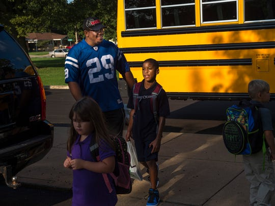Jaime Jr., 9, and Jaime Higgins Sr., arrive at Caze Elementary School for the first day of school Wednesday morning. The elder Higgins was taking part in the Million Father March. The march is a way for dad's to become more active in their kids' lives and hopefully keep them involved throughout the school year.