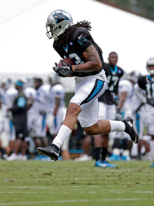 FILE - In this Aug. 8, 2016, file photo, Carolina Panthers' Kelvin Benjamin catches a pass during an NFL training camp practice in Spartanburg, S.C. Cam Newton became an NFL Most Valuable Player and led his team to the Super Bowl last season without the services of his favorite wide receiver Kelvin Benjamin.  So there is plenty of curiosity over what the Panthers can accomplish this year on offense with Benjamin back from a torn ACL.   (AP Photo/Chuck Burton, File)