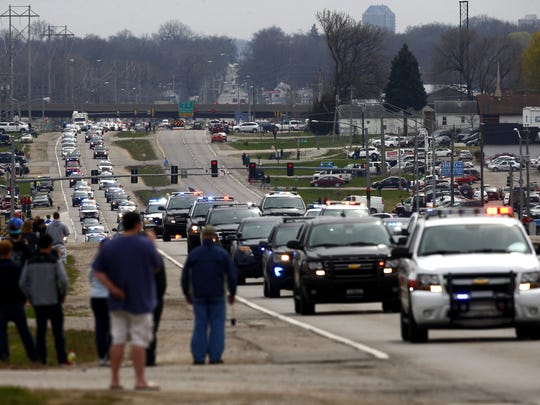 Police officers, family members and supporters gather at Highland Memorial Gardens Cemetery as Officer Susan Farrell is laid to rest in Des Moines on Wednesday, March 30, 2016. Farrell was one of the officers killed in a car crash early Saturday morning on Interstate 80.