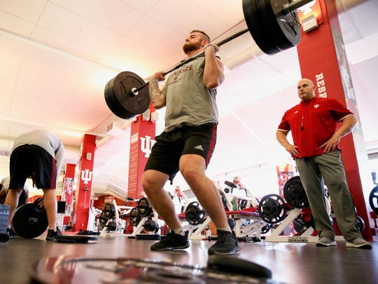 New IU strength and conditioning coach David Ballou works out an unidentified player.