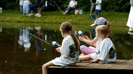 Children wait on a bite during last year's Fishing Rodeo.