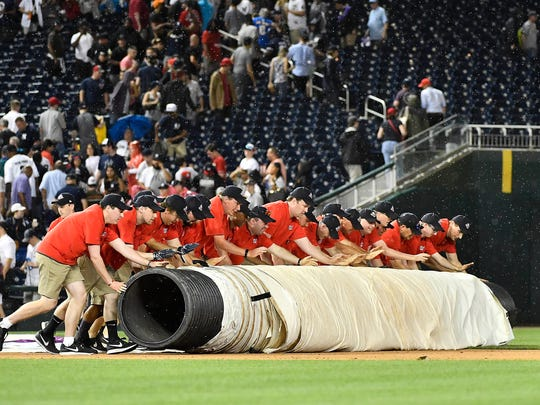 Washington Nationals grounds crew roll out the tarp