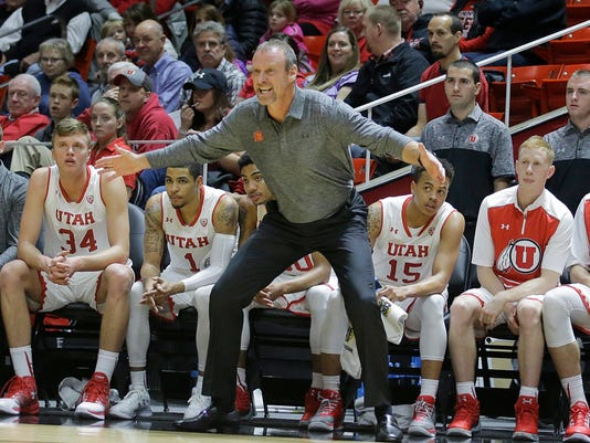 FILE - In this Jan. 1, 2017, file photo, Utah coach Larry Krystkowiak shouts to his team during the first half of an NCAA college basketball game against Colorado in Salt Lake City. Utah is exceeding expectations after being picked to finish eighth in the Pac-12. The Utes received their first vote in the AP Top 25 poll this week and sit fourth in the conference standings, behind No. 8 UCLA, No. 7 Arizona and No. 10 Oregon. (AP Photo/Rick Bowmer, File)