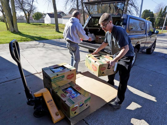 Steve Rankin, left, of St. Luke United Methodist Food Pantry, delivers produce that was outdated but still good from the Plymouth Walmart to the Sheboygan County Foodbank Wednesday November 9, 2016 in Sheboygan. At right is volunteer Brandon Roethel.