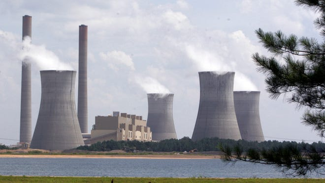 In this July 10, 2007, file photo, the coal-fired Plant Scherer in operation at Juliette, Ga. For the second year in a row, the EPA's data shows that the largest greenhouse gas polluter in the nation in 2011 was the Scherer power plant in Juliette.