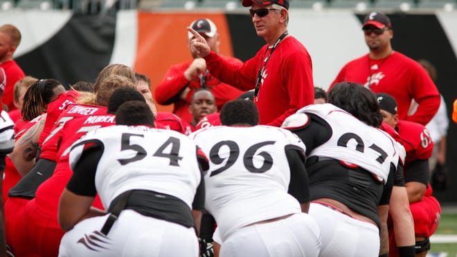 """University of Cincinnati head football coach Tommy Tuberville talks to his team. The NCAA's dispensation to the """"Power 5"""" could hurt schools like UC."""