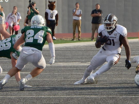 Western Michigan running back Jarvion Franklin (31) looks to elude Eastern Michigan defensive back Brodie Hoying (24) on Saturday in Ypsilanti.