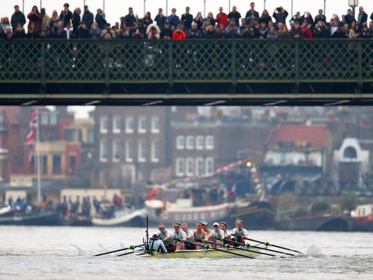 Watkins Glen native Olivia Coffey, second from front, rows for Cambridge against Oxford as fans watch from above during the Cancer Research UK Boat Race on March 24 on the River Thames in London.