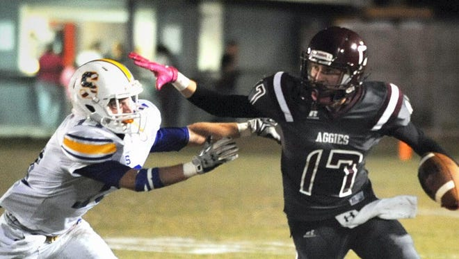 FCAHS' Austin McCray (17) fights off a Sumrall defender during a game on Oct. 23 at Henley Field in Brooklyn.