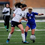 Marysville senior Kenzie Weingartz and Cros-Lex senior Sarah Stevens fight for possession during a soccer game Friday, April 22, 2016 at Marysville High School.