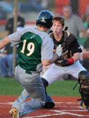 New Albany's Christian Sifers (right) prepares to tag out Floyd Central's Braxton Cerqueria (19) at home plate on Wednesday at Mount Tabor Baseball Park in New Albany. (Photo by David Lee Hartlage, Special to The Courier-Journal) April 12, 2017