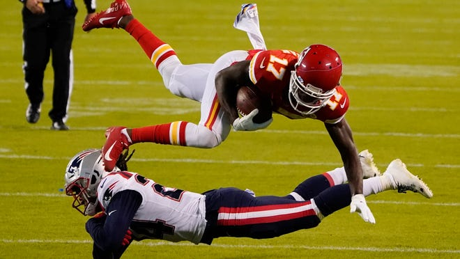 Kansas City Chiefs wide receiver Mecole Hardman (17) is tackled by New England Patriots cornerback Stephon Gilmore after catching a pass during the second half of an NFL football game, Monday, Oct. 5, 2020, in Kansas City.