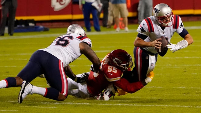 New England Patriots quarterback Brian Hoyer (2) is sacked by Kansas City Chiefs defensive end Frank Clark (55) during the first half of an NFL football game, Monday, Oct. 5, 2020, in Kansas City.
