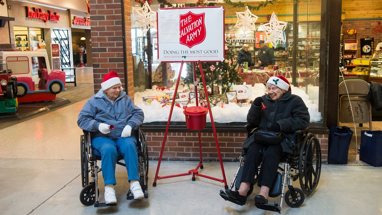 Cecilia Sheldt, 102, and Lorraine Carter, 85, ring Salvation Army bells at the North Hanover Mall.