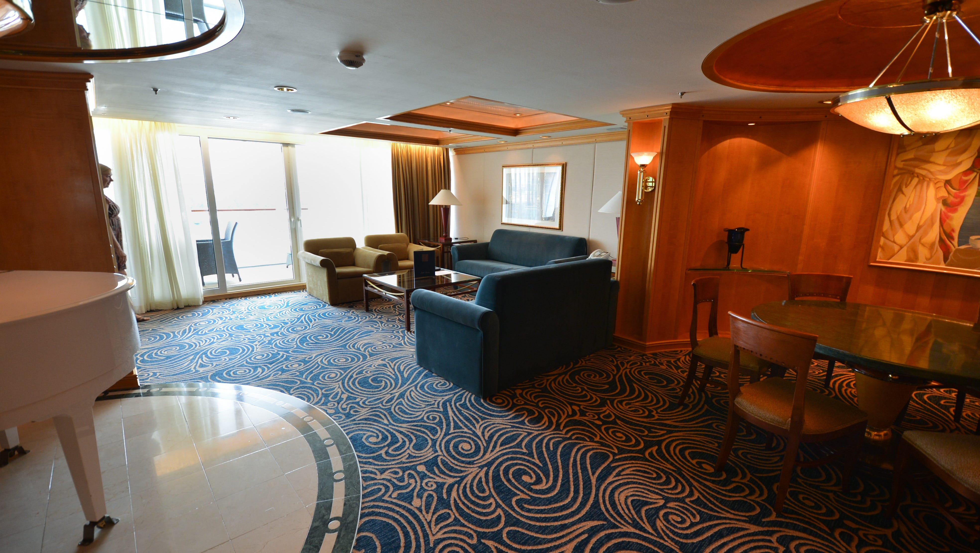 The largest cabin on Grandeur of the Seas is the 1,087-square-foot Royal Suite with Balcony on Deck 8, which features a large living area with a full-size sofa bed.