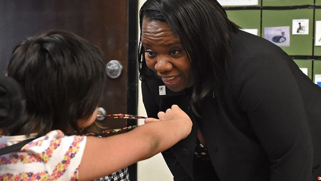 WCSD superintendent Traci Davis interacts with a student at Picollo School on the first day of school on Monday August 8, 2016.