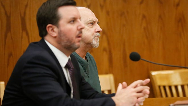Dennis Brantner sits with his attorney Craig Powell during his hearing for a re-trial for the murder of Berit Beck.
