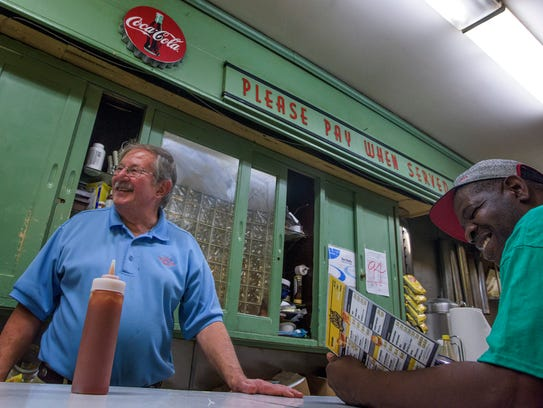 Theo Katechis works the counter at Chris' Hot Dogs