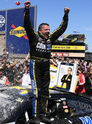 Tony Stewart celebrates in victory lane at Sonoma Raceway.