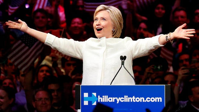 Democratic presidential candidate Hillary Clinton gestures June 7, 2016, as she greets supporters at a presidential primary election night rally in New York.