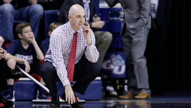 South Dakota head coach Craig Smith watches during the first half of an NCAA college basketball game against Gonzaga in Spokane, Wash., Wednesday, Dec. 21, 2016. (AP Photo/Young Kwak)