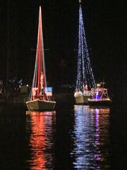 A scene from Venetian Night on the riverfront Sunday