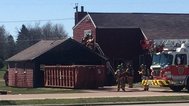 Firefighters at 4801 E. Linden Lane on Friday.