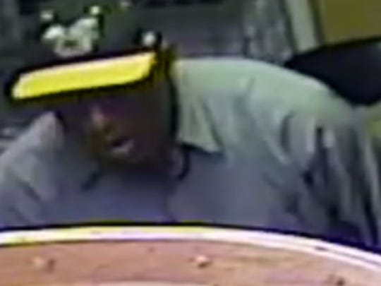 Suspect wanted in business robbery.