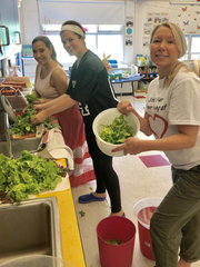 School No. 4 teachers washing lettuce that was harvested from the school's garden for a salad bar party for students on June 20. From left are Maria Cioffi, Jamie Schrafft and Melissa Miceli.