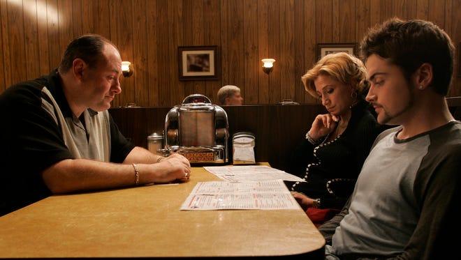 "James Gandolfini as Tony Soprano, Edie Falco as Carmela and Robert Iler as Anthony Jr. in a scene from the finale of, ""The Sopranos."""