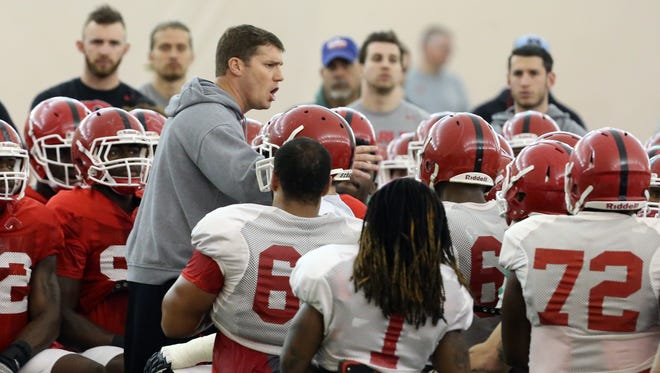 Rutgers football players resume their Spring practice sessions at the practice bubble on the Piscataway Campus on Thursday April 7, 2016Rutgers football head coach Chris Ash (center) addresses his team during practice.