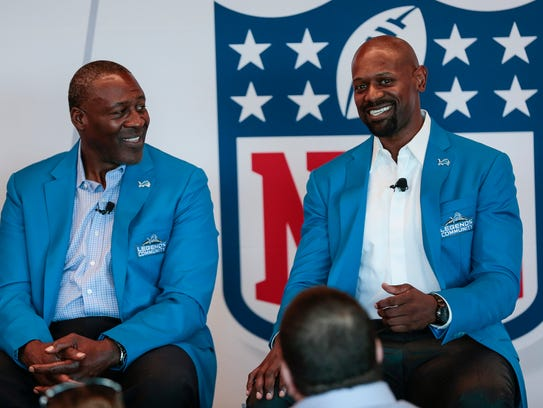 Former Detroit Lions receiver Herman Moore, right,