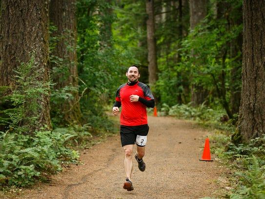A participant runs through Silver Falls State Park