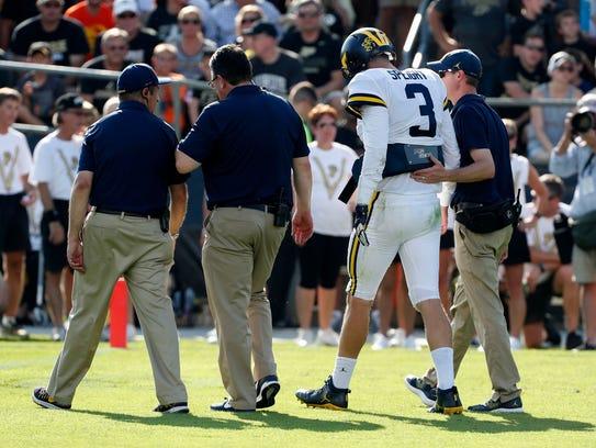 Sept. 23: Michigan quarterback Wilton Speight walks