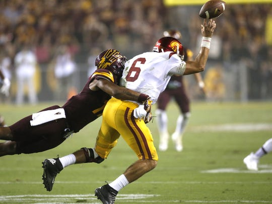 Arizona State University Ismael Murphy-Richardson tackles University Southern California quarterback Cody Kessler during a college football at Sun Devil Stadium in Tempe on Saturday, September 26, 2015.