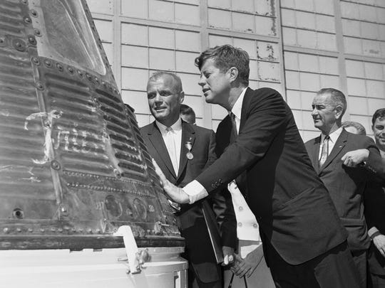 In this Feb. 23, 1962 file photo, astronaut John Glenn and President John F. Kennedy inspect the Friendship 7, the Mercury capsule in which Glenn became the first American to orbit the earth. Kennedy presented the Distinguished Service medal to Glenn at Cape Canaveral, Fla.
