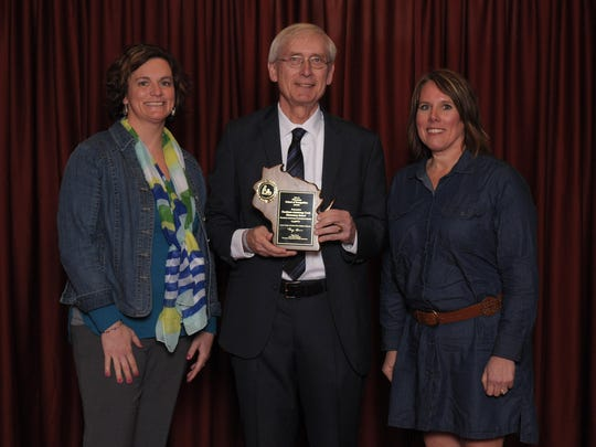Thomas Jefferson teacher Jill Ebersold joins State Superintendent Tony Evers and Principal Cathy Prozanski for the award presentation.