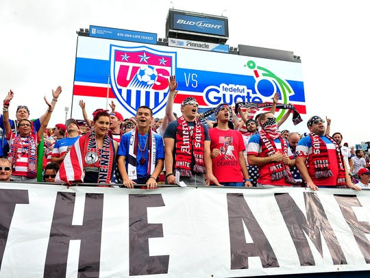 USA supporters cheer for their team against Guatemala