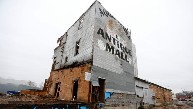 A crew of Amish workers is dismantling the former Hawkins Mill at College Street and Kansas Expressway. The historic building was built in 1940 according to a News-Leader story from 1999. It was originally powered by two diesel engines pulled from shrimp boats.
