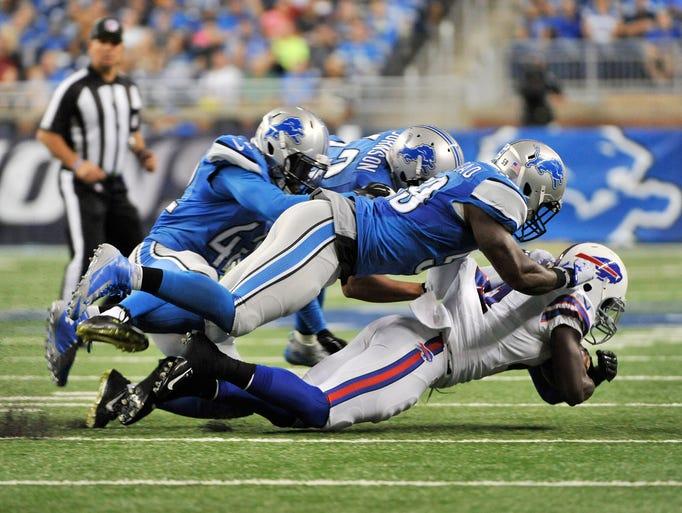 Lions linebacker Tahir Whitehead tackles Buffalo Bills