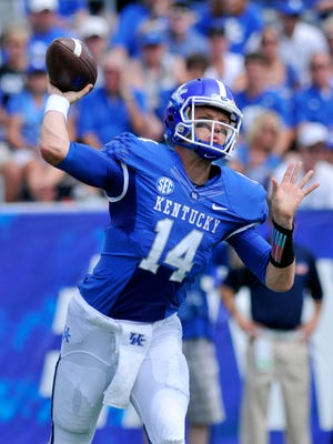 UK's Patrick Towles passes in the first half against UT Martin, Saturday, Aug. 30, 2014 at Commonwealth Stadium in Lexington. Photo by Tim Webb, Special to the CJ