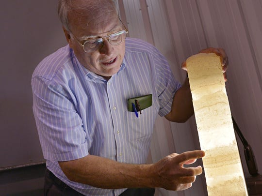 Western Michigan University professor emeritus William Harrison III, director of the Michigan Geological Repository for Research and Education, displays a core sample of potassium chloride, or potash, obtained more than a mile underground in Osceola County.