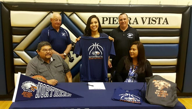 Piedra Vista's Monique Russell signed a letter of intent to play basketball at Northern New Mexico College on Friday at the Jerry A. Conner Fieldhouse.