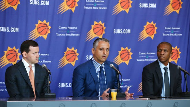 Phoenix Suns General Manager Ryan McDonough and James Jones, Vice President of Basketball Operations (right) with their new head coach Igor Kokoskov (center) during a press conference on May 14, 2018 at Taking Stick Resort Arena in Phoenix, Ariz.