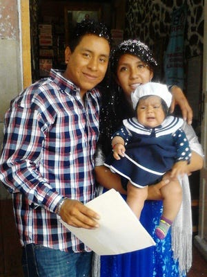 Juan Manuel Guardian-Romero poses with his wife, Lizet Romero, and daughter, Ariana Lizet Guardian, who live with him in Cherán, Mexico