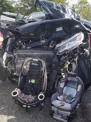 A Lancaster woman's photo of two undamaged car seats in front of her crumpled 2015 Honda CRV has gone viral, reminding parents of the importance of buckling children in their car seats correctly.